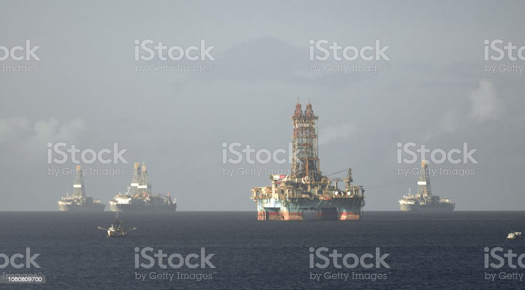 Offshore oil rig and drilling vessels in Chaguaramas Bay, Trinidad...