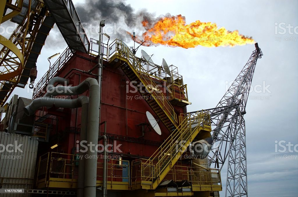Offshore oil rig and flame tower stock photo