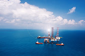 Offshore oil rig platform in the gulf from aerial view.Offshore oil rig platform in the gulf from aerial view.
