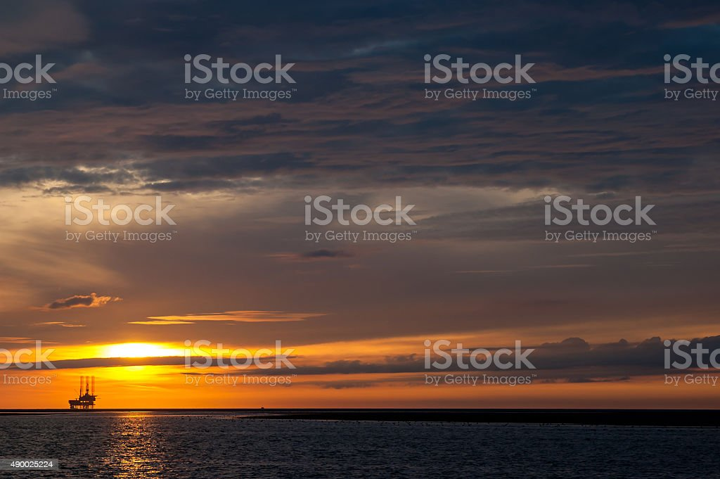 Offshore platform at sunset stock photo