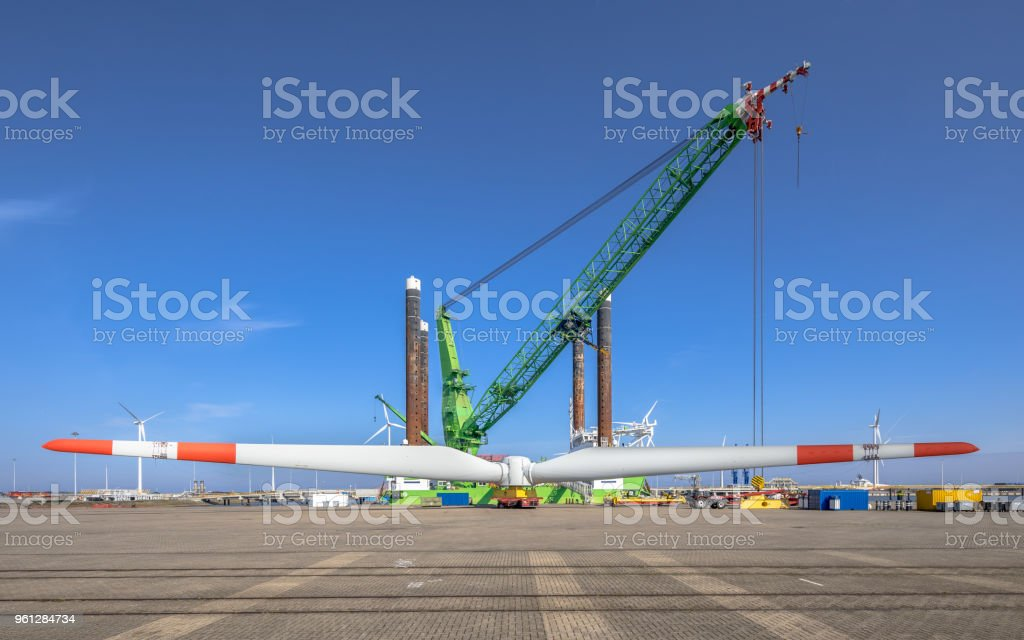 Offshore wind energy supply vessel loading rotor stock photo