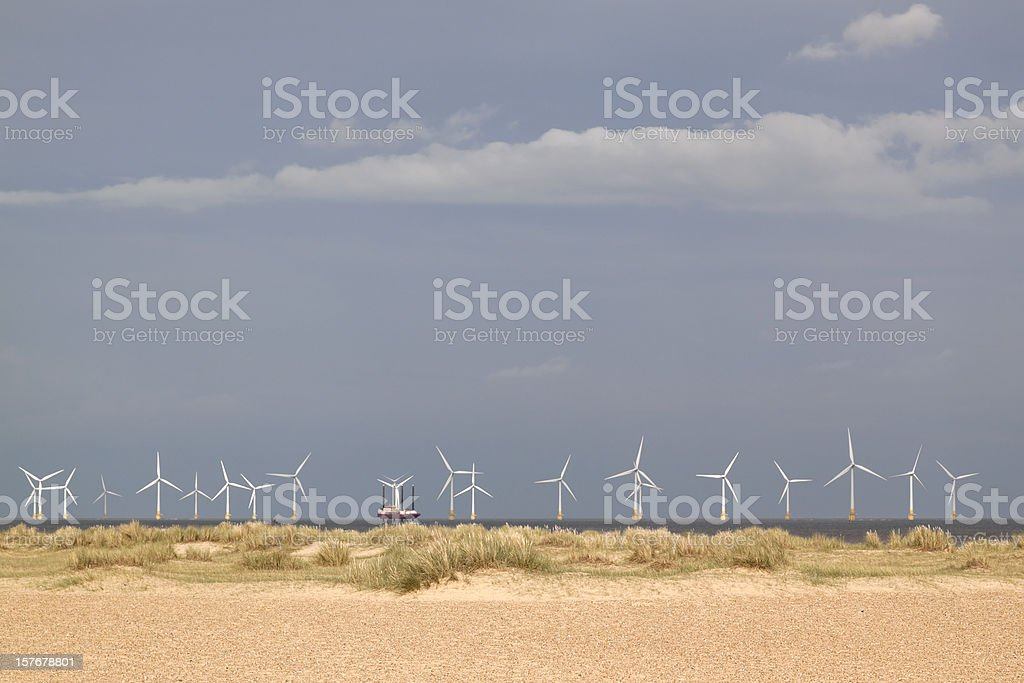 Off-shore wind farm with jack-up maintenance barge stock photo