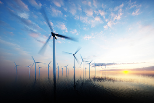 istock Offshore wind park at daybreak 607970894