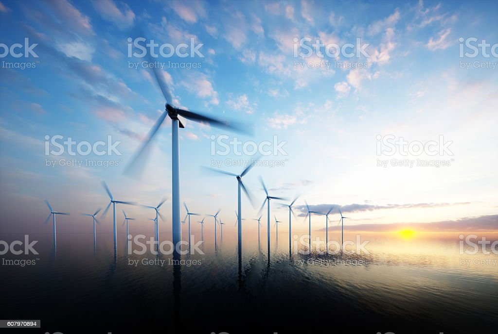 Offshore wind park at daybreak stock photo