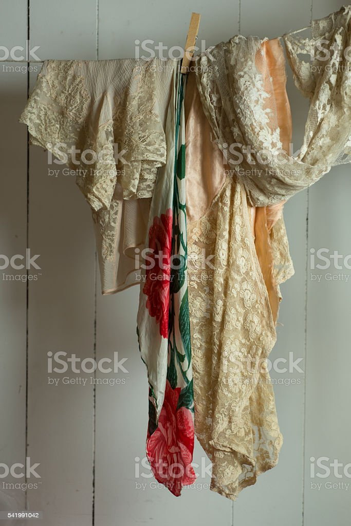 Off-White Lace Fabric Pinned to Clothesline stock photo
