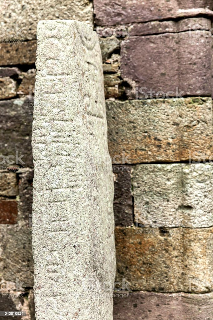 Ogham stone in a graveyard stock photo