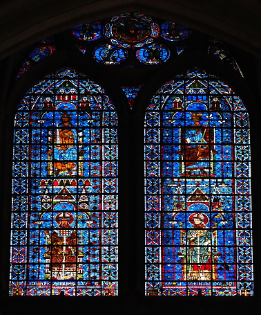 Reims Cathedral, stained glass windows dating 14th century. The king upleft is Clovis, upright is Saint Louis