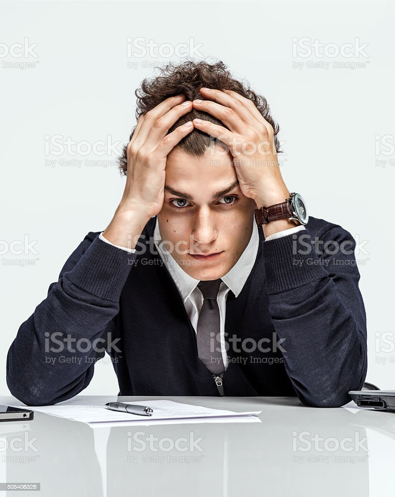 Oh my god, stressed businessman is taken for the head stock photo