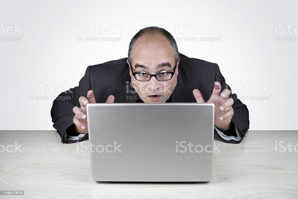 Oh no!- Office worker looks very surprised at his laptop royalty-free stock photo