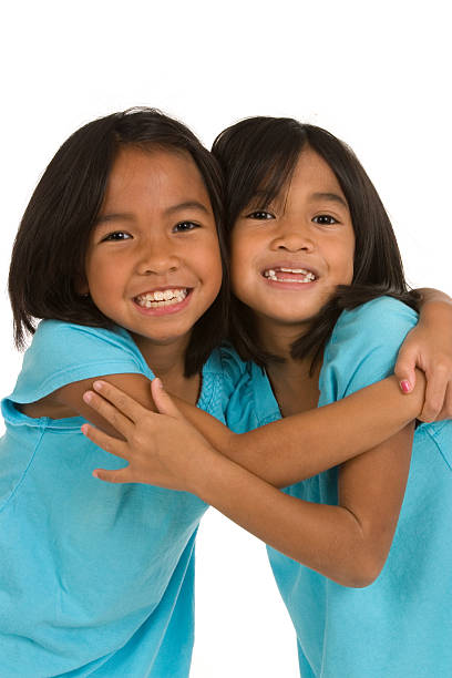 Oh so cute sisters stock photo