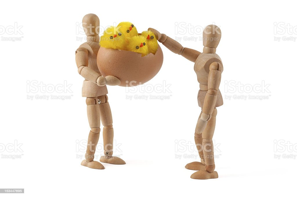 oh, they are fluffy. wooden mannequin and chicks stock photo