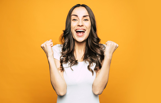 istock Oh, yeah! Boffo, excited and very beautiful girl is sharing about something cool and showing it with the gestures of her hand and the mimic of her young face. 1139415607