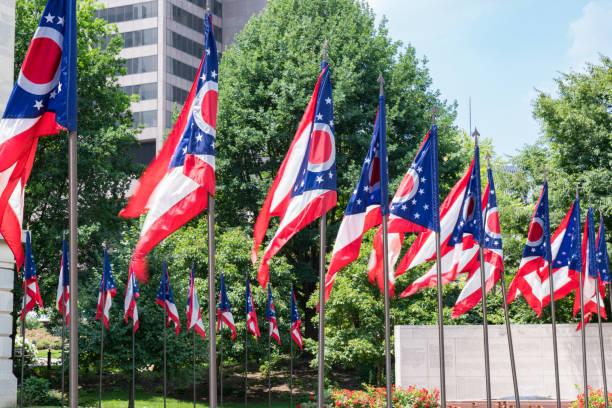 Ohio State Flags Ohio State Flags at the state capital in Capitol Square in Columbus, Ohio ohio stock pictures, royalty-free photos & images