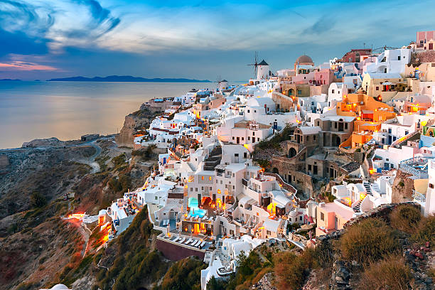 oia at sunset, santorini, greece - caldera bildbanksfoton och bilder
