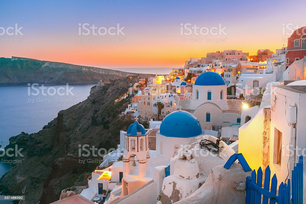 Oia at sunset, Santorini, Greece stock photo