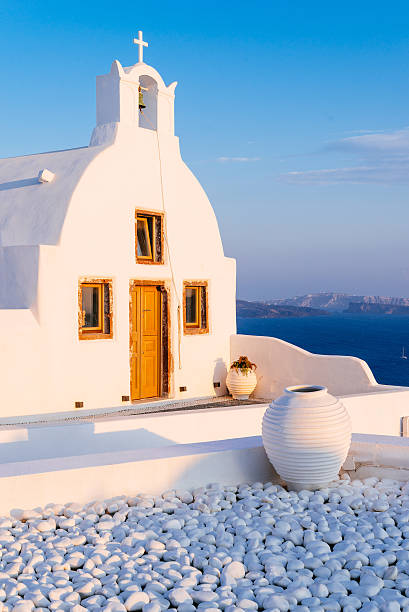Oia church in sunset stock photo
