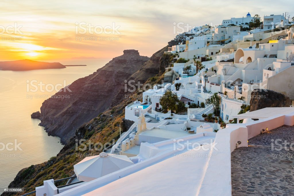 Oia luxury decks and patios at sunset stock photo