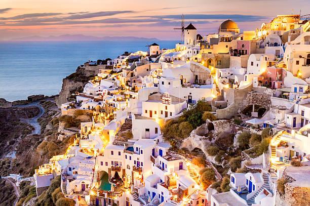 oia sunset, santorini, greece - santorini stock photos and pictures