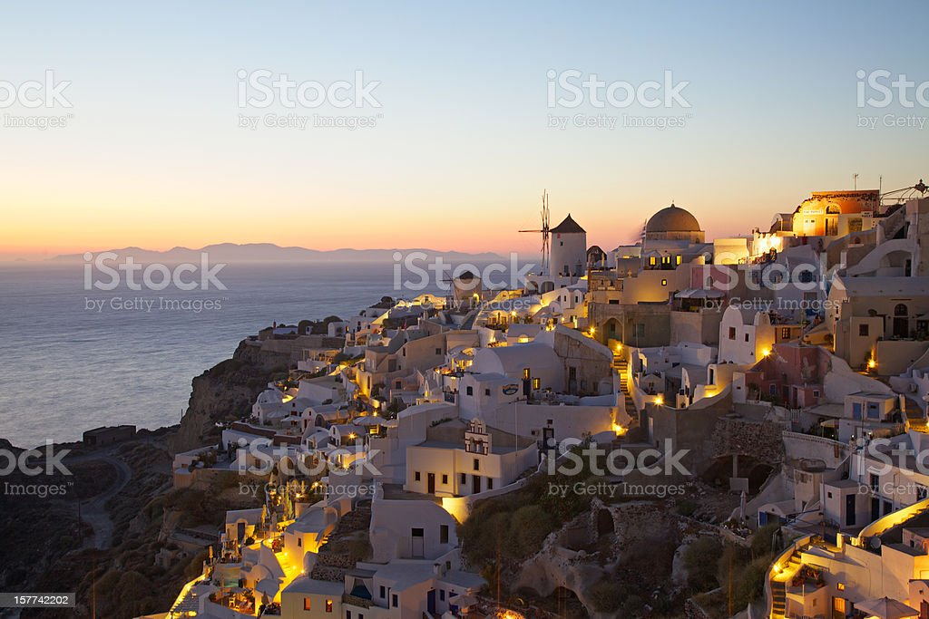 Oia village cityscape at sunset. Santorini. Greece. royalty-free stock photo
