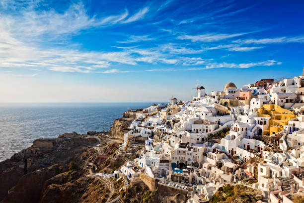oia village in santorini island with famous churches, greece - greek easter stock photos and pictures