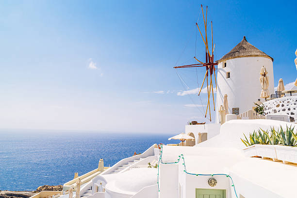 oia windmill sunset, greece - oia santorini bildbanksfoton och bilder