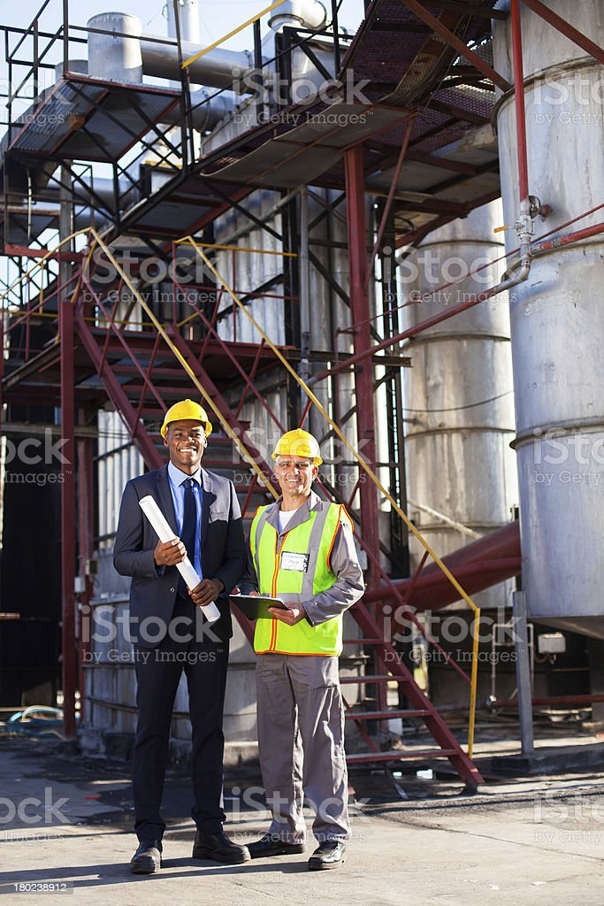 oil and chemical manager with factory worker royalty-free stock photo