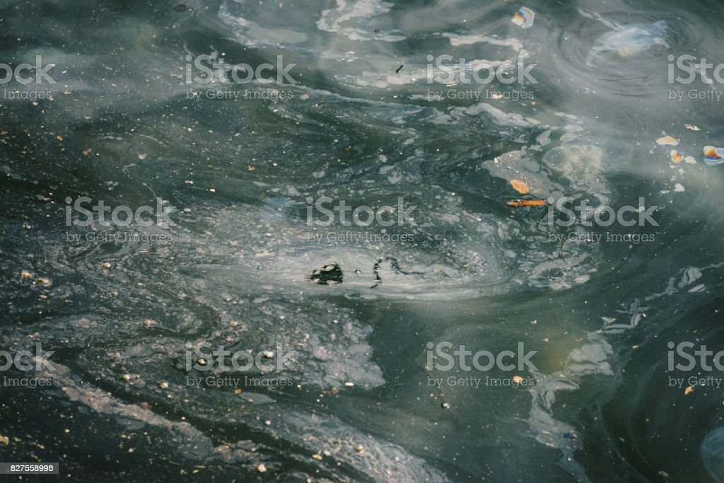 Oil and garbage pollution in the water. stock photo