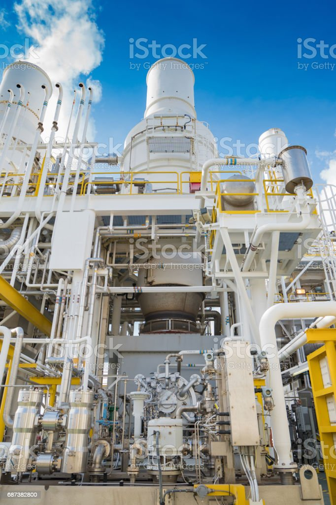 Oil and gas business, offshore oil and gas processing platform, feed gas turbine compressor and west heat recovery unit at the top of deck floor. stock photo