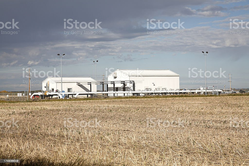 Oil And Gas Compressor Station Under Storm Clouds royalty-free stock photo
