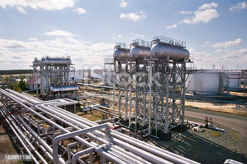 Oil and gas industry. The processing plant was photographed against the sun.