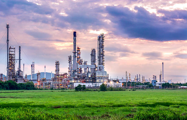 Oil and gas industry - refinery at sunset - factory stock photo
