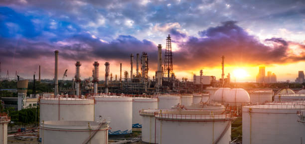 oil and gas industry - refinery factory - petrochemical plant at sunset - refinery stock photos and pictures