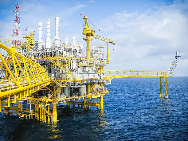Oil and gas platform in ocean, cloud, blue sky, walkway stock photo