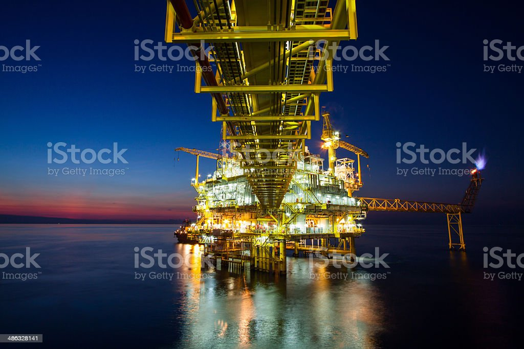 Oil and gas platform in sunset or sunrise time. royalty-free stock photo