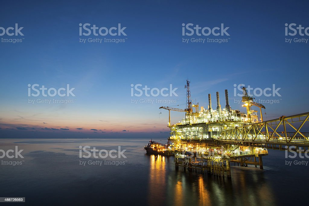 oil and gas platform in sunset or sunrise time. stock photo