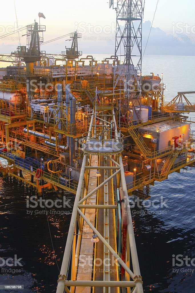 Oil and gas platform in sunset or sunrise time,Offshore oil and gas,...
