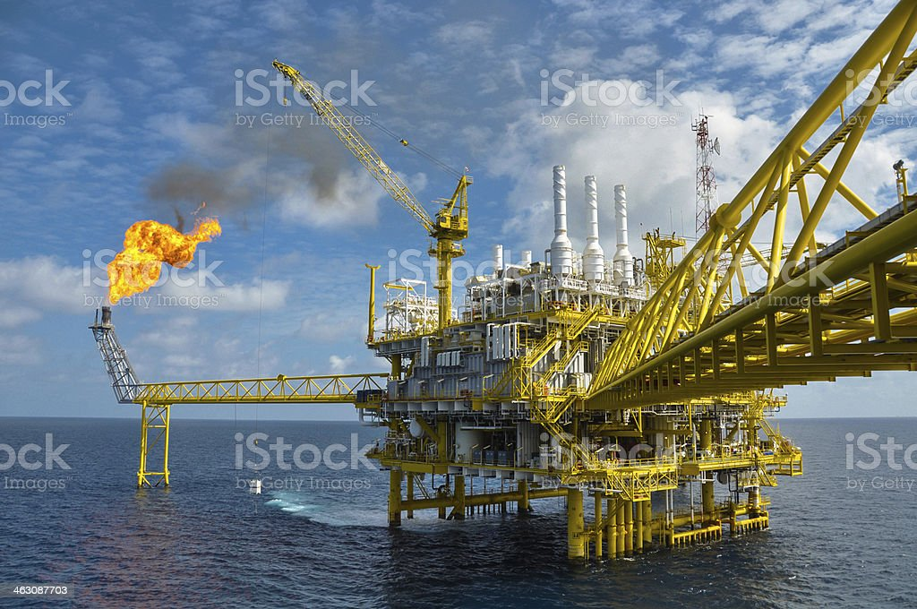 Oil and gas platform with burning stock photo