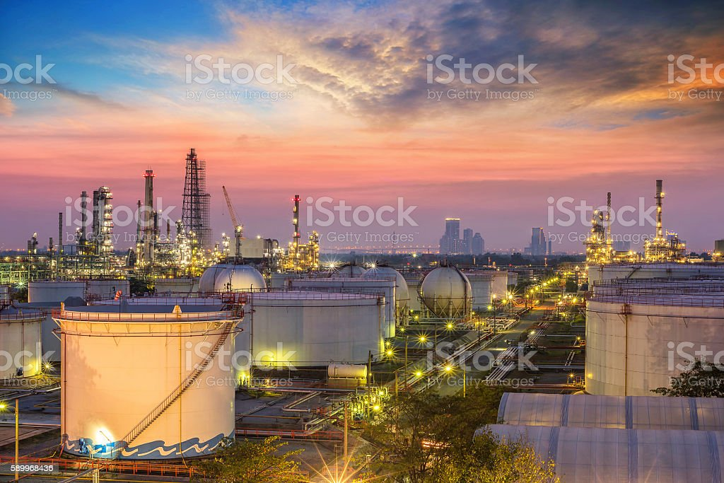 Oil and gas refinery at twilight stock photo