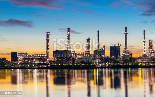 istock Oil and gas refinery industry plant with glitter lighting and sunrise in the morning, Factory of petroleum industrial, Power plant,Energy power station area. Industry 4.0 1165307276