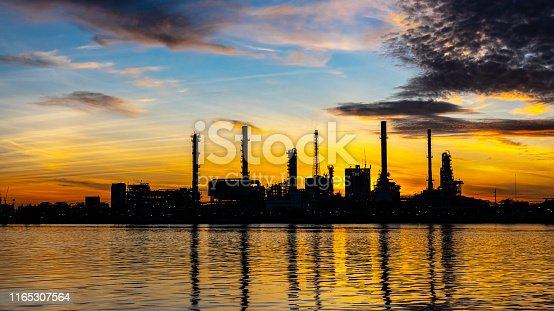 istock Oil and gas refinery industry plant with glitter lighting and sunrise in the morning, Factory of petroleum industrial, Power plant,Energy power station area. Industry 4.0 1165307564