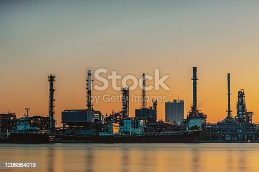 istock Oil and gas refinery industry plant with glitter lighting and sunrise in the morning, Factory of petroleum industrial, Per plant,Energy power station area. Industry 1206364019