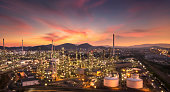 Top view, industrial pipelines and structures, large oil refineries, and beautiful sky after sunset.