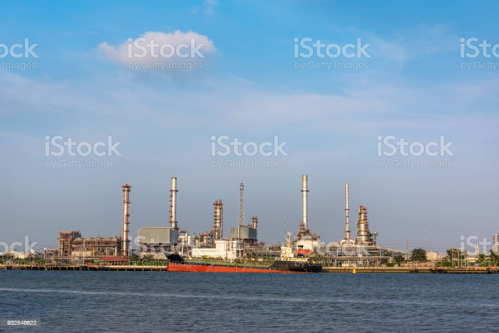 Oil and gas refinery plant with shipping loading dock at daylight stock photo