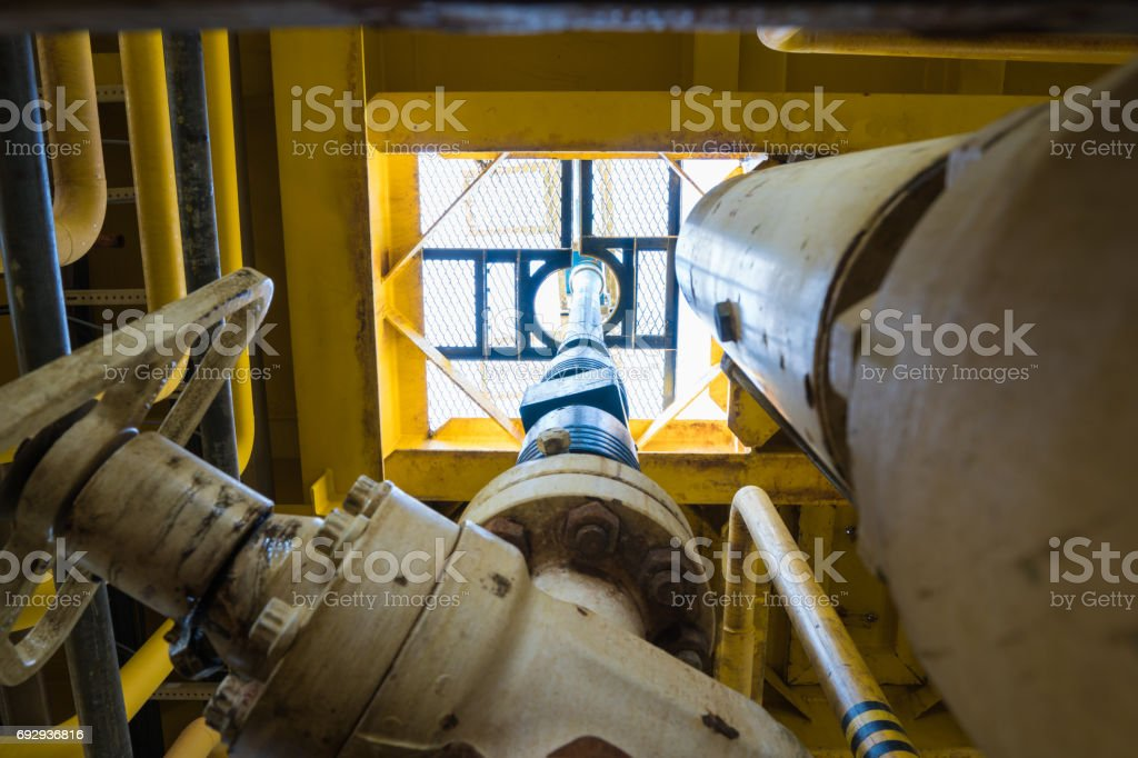 Oil and gas wire line and slick line pressure control equipment,  lubricator and blow out preventive connected at production x-mas tree for drift run and clear obstruction in production tubing at offshore oil and gas remote wellhead platform stock photo