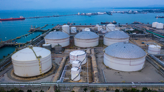 Oil and petrochemical tank, storage of oil and petrochemical products ready for logistic and transport business. Aerial view.