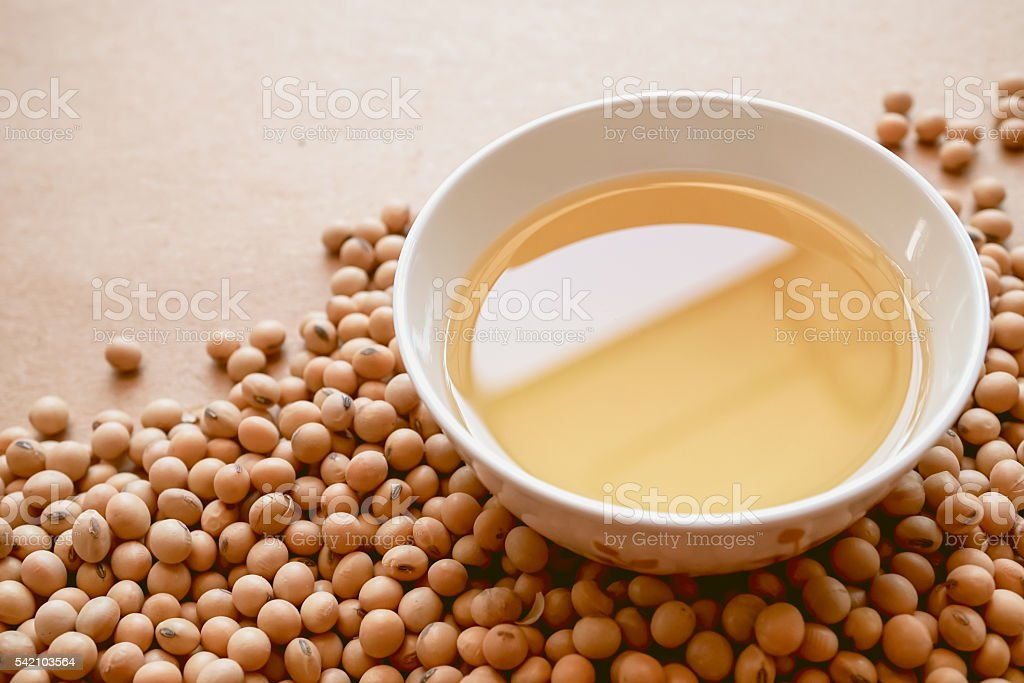 oil and soy beans on brown paper - Photo