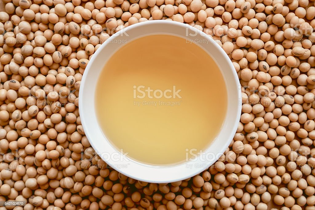 oil and soy beans on brown paper stock photo