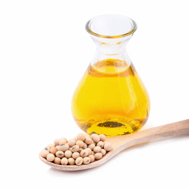 oil and soybean close up on white background. stock photo