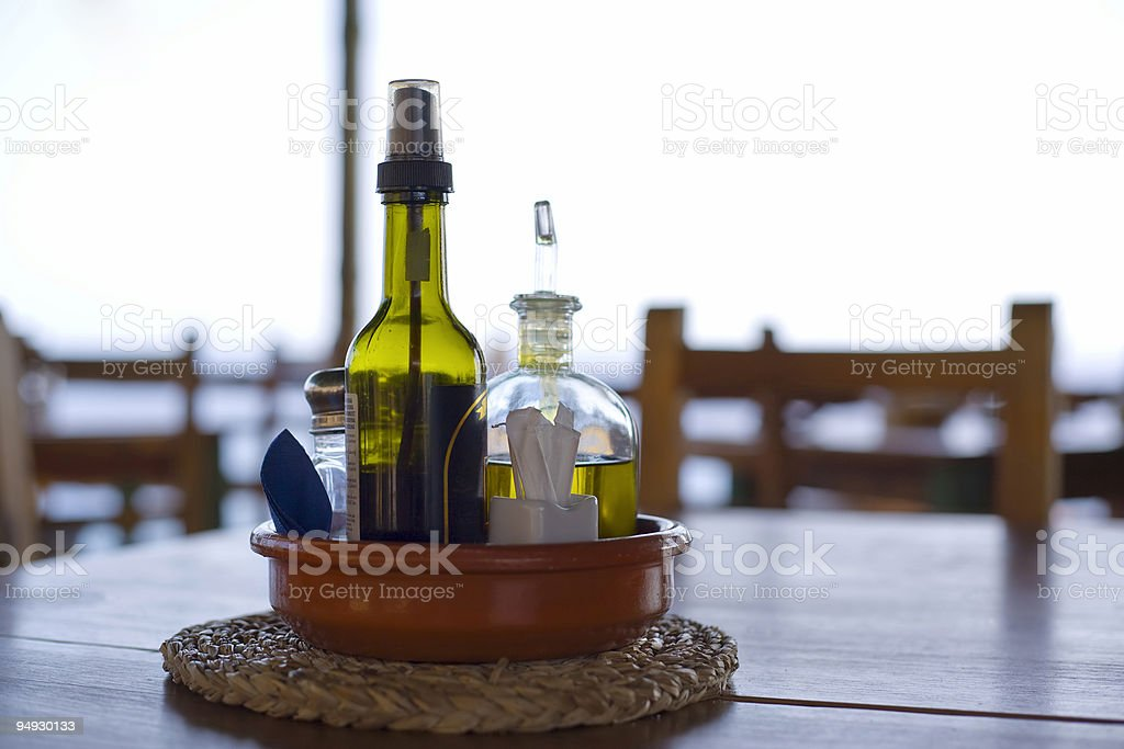 oil and vinegar on table at beach bar, backlight royalty-free stock photo