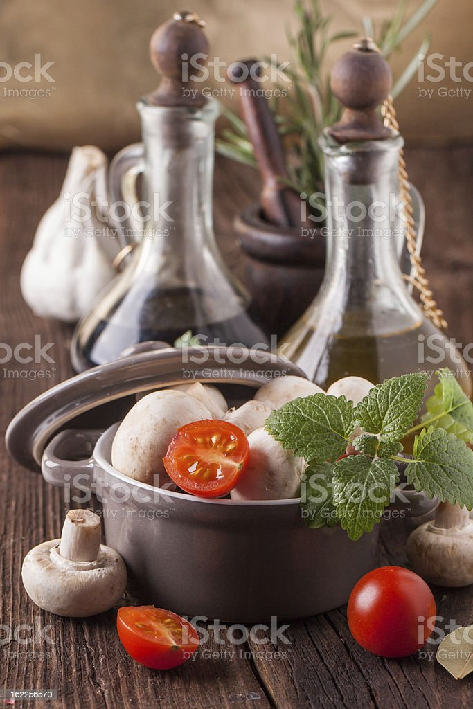 oil and vinegar with mushrooms in pan royalty-free stock photo
